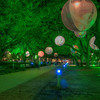 Another view of the green-lit path in Discovery Green.