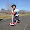 It was a great day to be playing outside at Doyle Field in Leominster on Monday. On his Radio Flyer scooter on the track at the park is Daniel Geil, 3, of Leominster. SENTINEL & ENTERPRISE/JOHN LOVE
