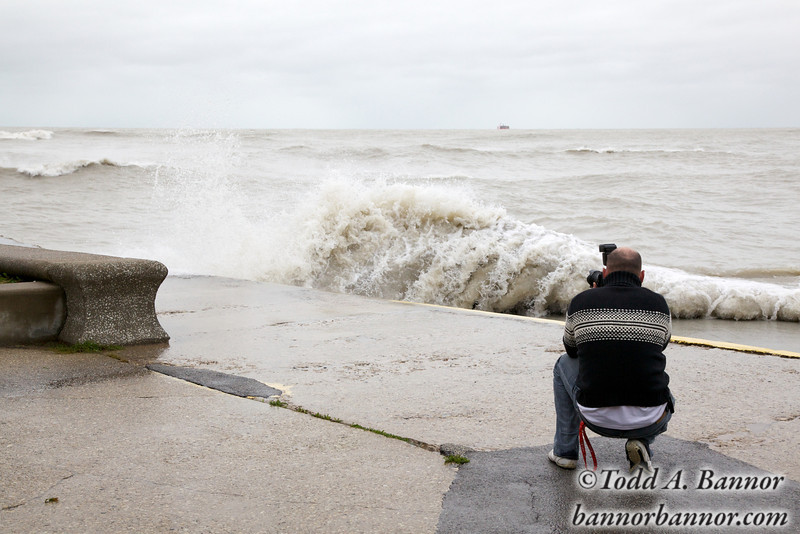 Photographer photographing large waves on Chicago lakefront.