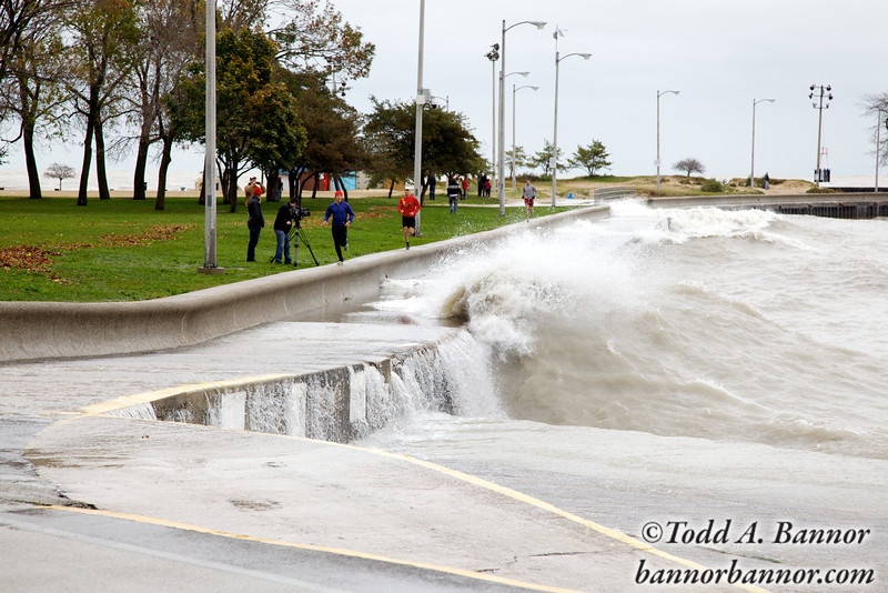 "Joggers on the seawall at North Avenue Beach and large waves. I think the guy in the blue is having an ""uh oh"" moment."