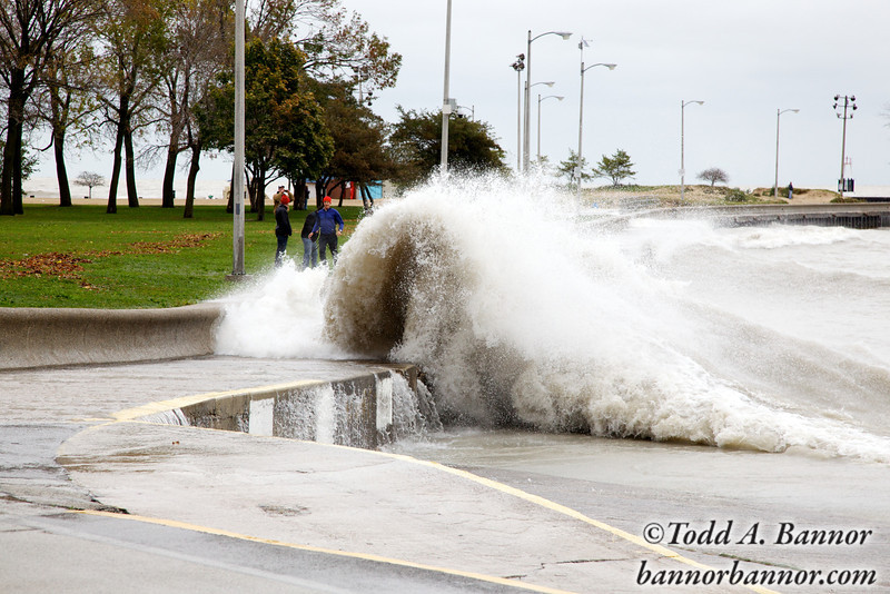 Joggers on the seawall at North Avenue Beach and large waves. Looks pretty close.
