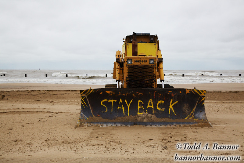 A bull dozer turned into a warning sign on North Avenue Beach.