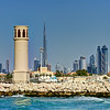Dubai. Wind Tower at the Dubai Offshore Sailing Club marina. Burj Khalifa and Business Bay in the background.