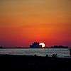 Sun setting behind the Atlantis Hotel on the Palm as seen from Kite Beach in Dubai.