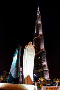 Dubai. Statue and Burj Khalifa.