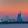 Sunset at Nessnass Beach in Dubai. Burj Al Arab and the Marina in the distance.