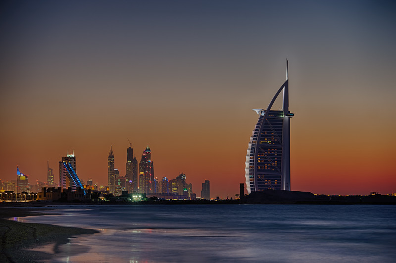Dubai. Burj Al Arab and Dubai Marina at sunset as seen from Kite Beach.