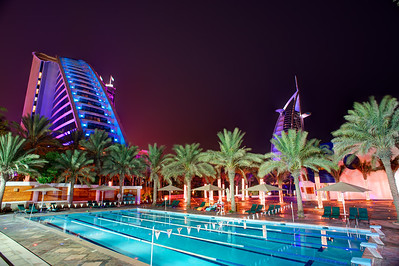 Dubai. Pool next to the Jumeirah Beach Hotel and Burj Dubai in the background.