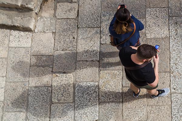 Tourists taking photos on their phones