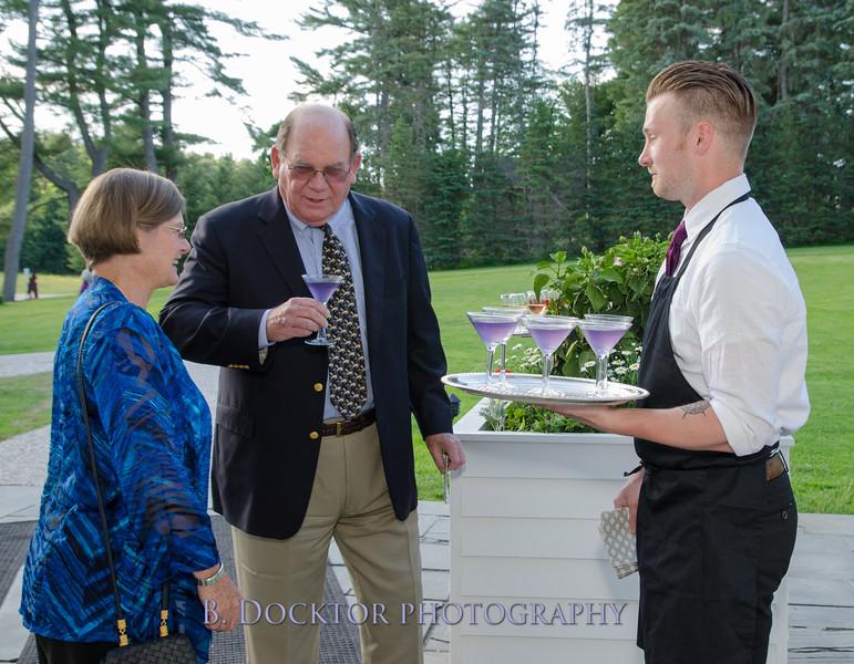 Rusty Mott, Vita Mott, Billy Keane serving the purple liqueur called blue moon