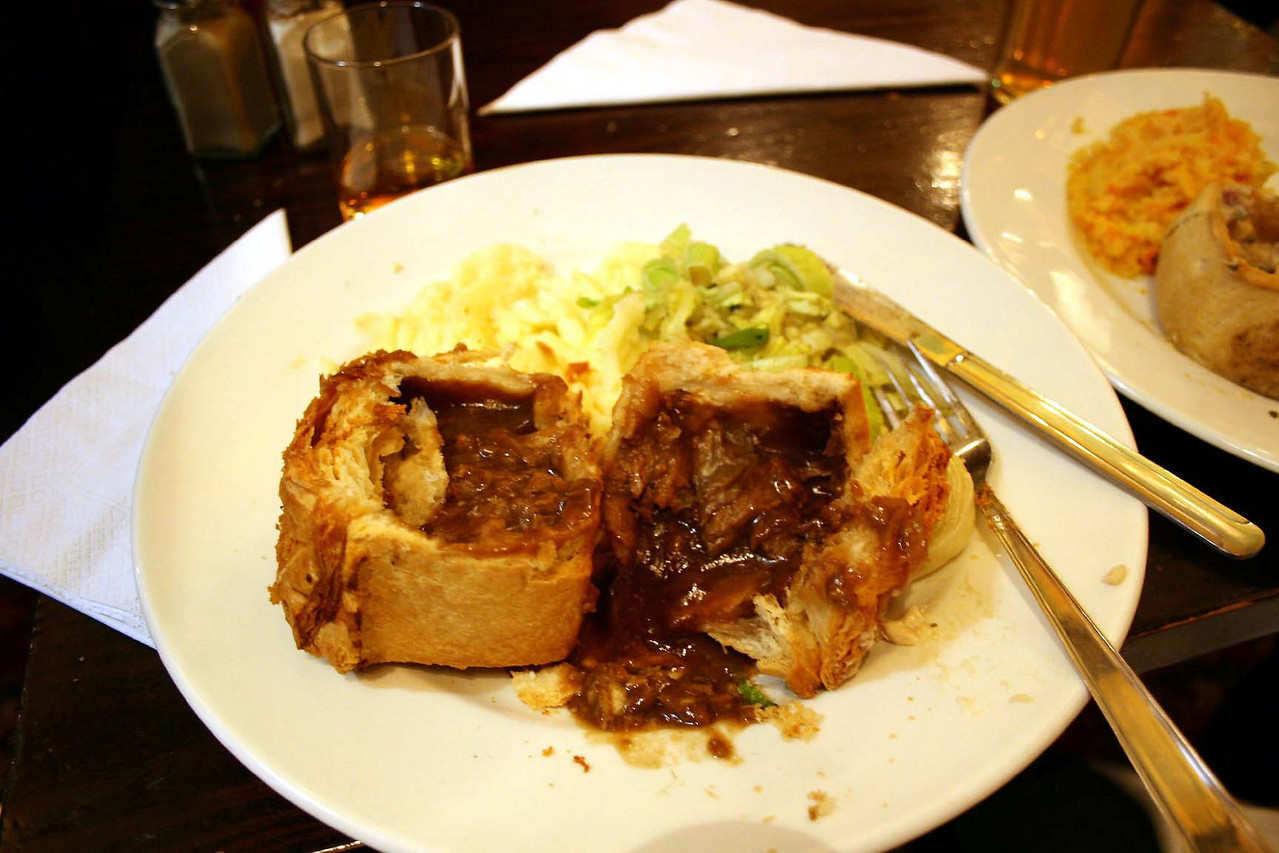 Pub food-meat pies and greens.