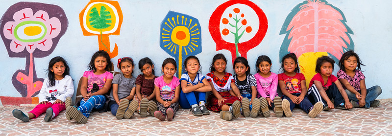 Cute little Mayan girls on break at a school for Mayan children outside Antigua , Guatemala