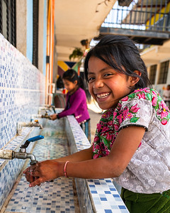 Happy Young Mayan Girl Washing Hands in Guatemala