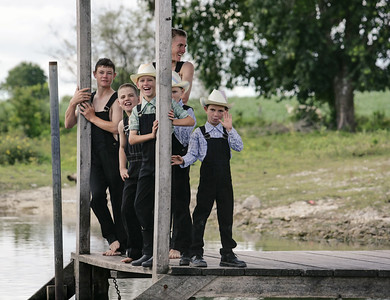 Mennonite Boys playing at the River, Belize