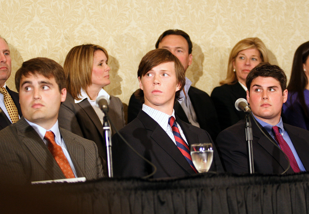 The three Duke Lacrosse players, (right to left) Reade Seligmann, Collin Finnerty, and David Evans,acquitted of rape  listen to lead attorney Joe Cheshire at the defense's press conference in Downtown Raleigh on April 11, 2007.