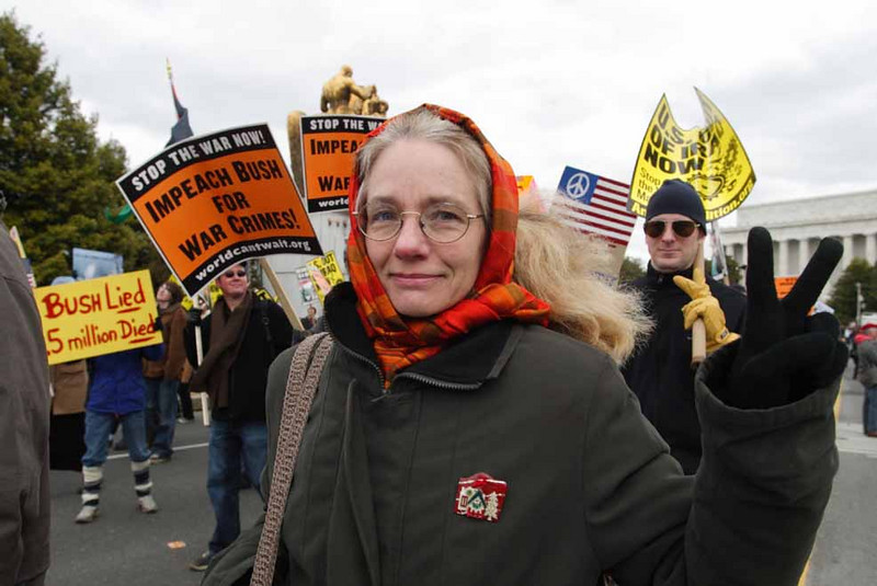 A marcher holds up a peace sign at the big anti-war protest in Washington DC on March 30, 2007