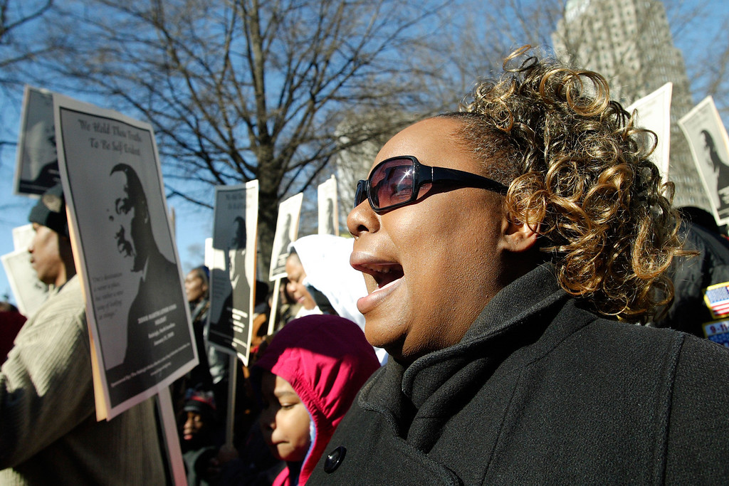 A lady sings at the 2008 Martin Luther King Jr. Memorial March in Downtown Raleigh; January 2008.