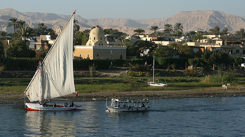 View of mosque and small boats along Nile.