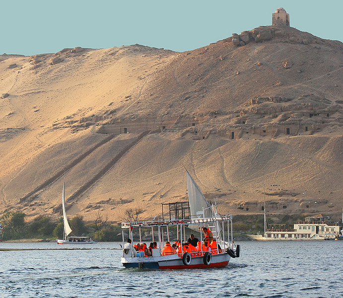 Viewing ancient ruins and tombs along Nile.