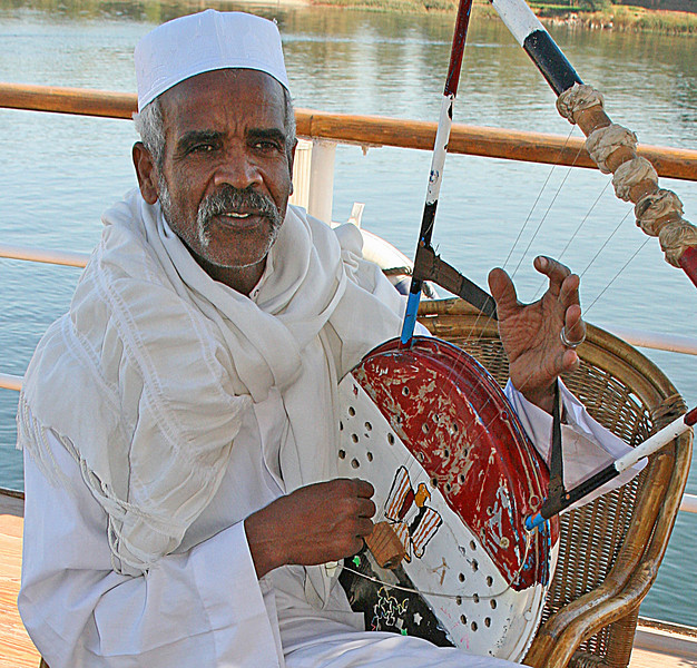 Nubian musician. Nubians were from the Sudan and arrived on board to entertain us.  As an aside...Anwar Sadat was also Nubian.