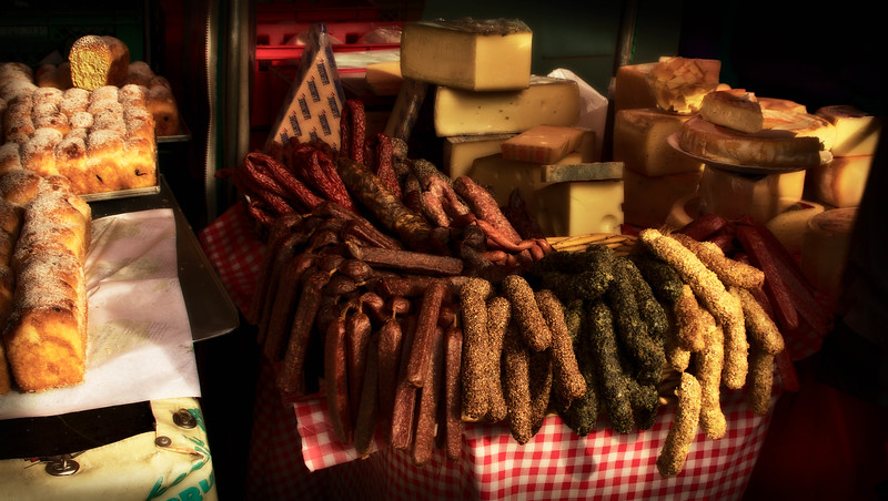 My 3 favorite food groups here - sausage, cheese and bread!  This was taken in a food market in Salzburg.<br /> Photo © Cindy Clark
