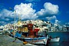 Colorful fishing boats in Naxos harbor, Cyclades Islands, Greece. <br /> Photo © Carl Clark