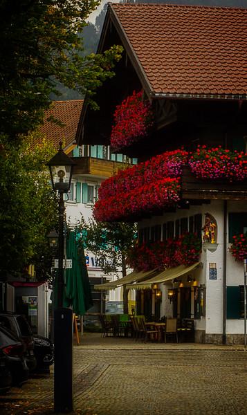 Charming street scene in Oberammergau, Bavaria.<br /> Photo © Cindy Clark