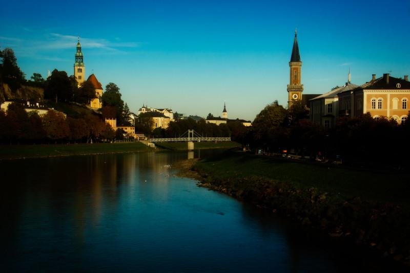 The Salzach flows peacefully on a fine day in Salzburg.<br /> Photo © Carl Clark