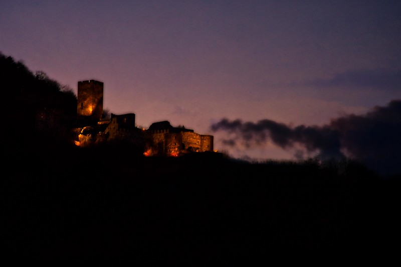 Castle lit up at dusk in the Wachau Valley, Austria.<br /> © Cindy Clark