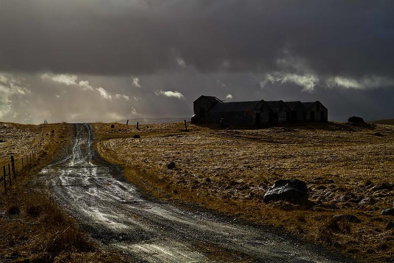 Skirting a storm on farmland near Hofsvik.<br /> Photo © Carl Clark