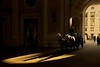 Horses pulling one of the many carriages through Hofburg Palace in Vienna.<br /> Photo © Carl Clark