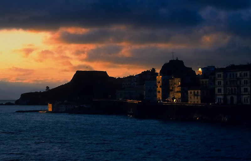 The Old Fort (Paleo Frourio) silhouetted against the sunrise on Corfu, Greece. <br /> Photo © Carl Clark