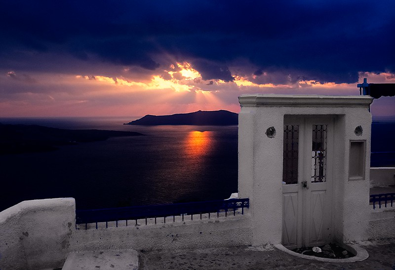 A doorway to the sunset on Santorini, Cyclades Islands, Greece. <br /> Photo © Carl Clark