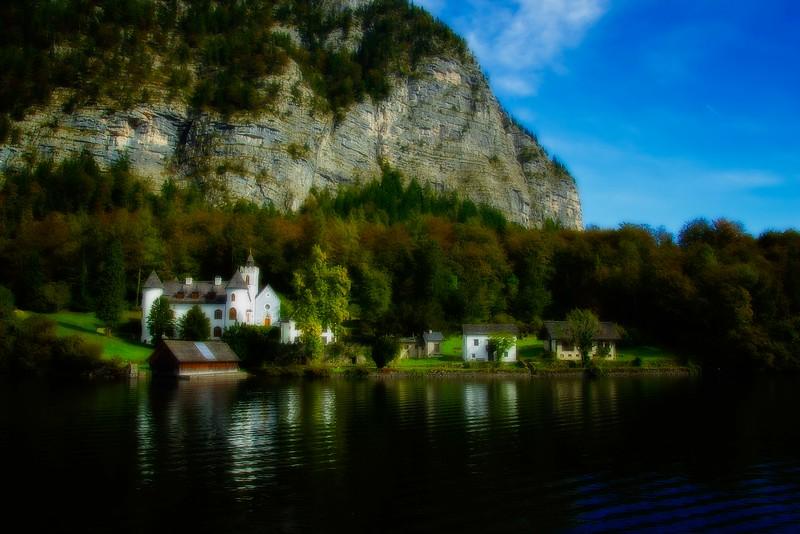 Schloss Grub, a charming castle across Hallstatt See from the village of Hallstatt, Austria.<br /> Photo © Carl Clark
