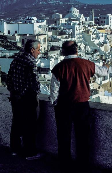 Talk of the day on Santorini, Cyclades Islands, Greece.<br /> Photo © Carl Clark