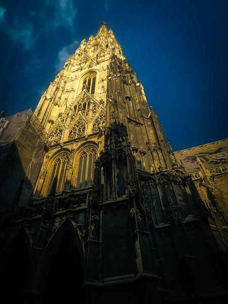 Consecrated in 1147, St. Stephen's Cathedral's Romanesque and later added Gothic architecture soars into the Vienna sky.<br /> Photo © Cindy Clark