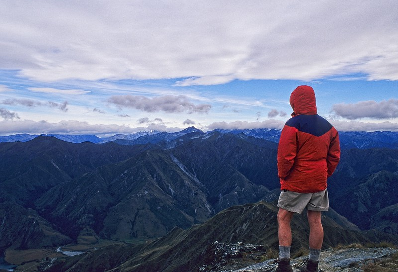 Enjoying a chilly view from the summit of Ben Lomond near Queenstown, New Zealand.<br /> Photo © Carl Clark
