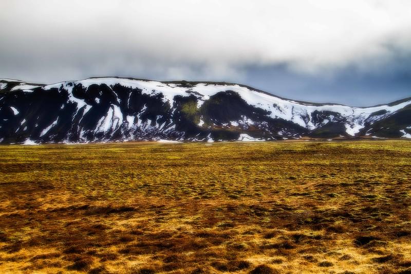 Tundra and snow covered basalt hills near Þingvallavatn.<br /> Photo © Carl Clark