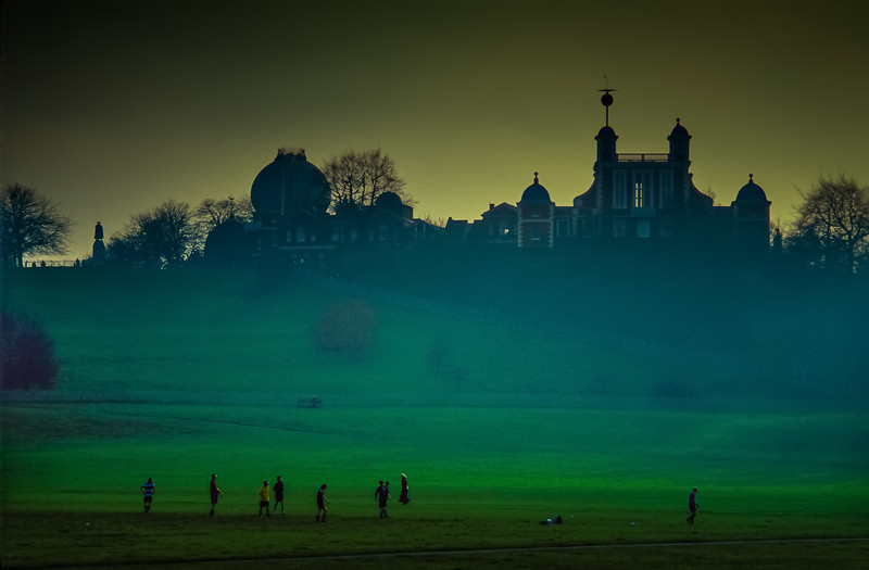 Greenwich Observatory looms above boys playing soccer in England.<br /> Photo © Cindy Clark