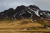 A remote cabin under stark hills on the Vesturland peninsula.<br /> Photo © Carl Clark
