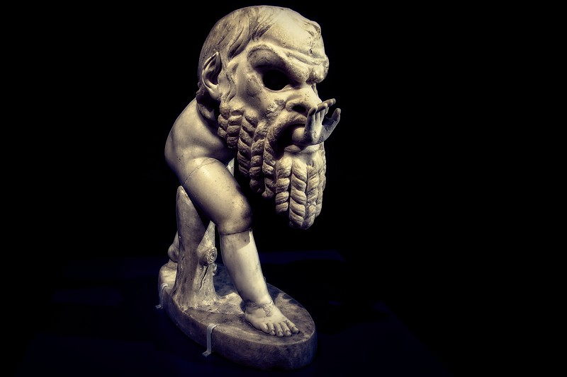 Statue of a Young Satyr Wearing a Theater Mask of Silenos, ca. 1st century CE. Anonymous sculptor, with 1628 restorations by Alessandro Algardi. At the Kunsthistorisches Museum, Vienna.<br /> © Cindy Clark