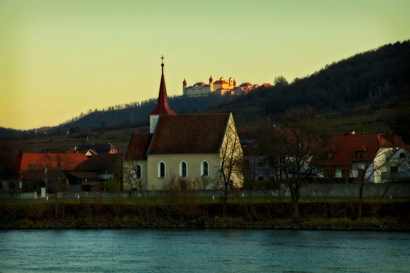 High above the Austrian village of Hundsheim and Johanneskirche on the sits Göttweig Abbey.<br /> Photo © Carl Clark