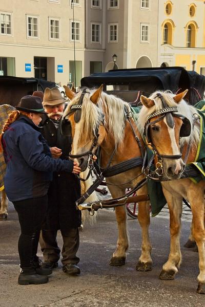 Caring for the horses near Mozartplatz in Salzburg.<br /> Photo © Carl Clark