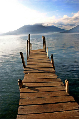 Boat dock on lake with volcano- Lake Atitlan, Guatemala