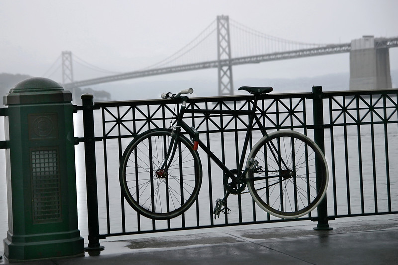 Bike and Bay Bride in the fog and rain- Ferry Building, San Francisco