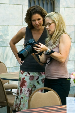 "<font size=""3"">Laurie demonstrates camera features to one of the students.</font>"