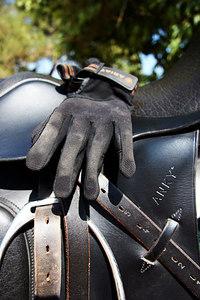 Glove on saddle