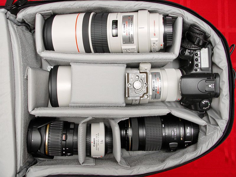 "Computrekker AW full of glass - 300/4 IS, 400/5.6 mounted on 20D, Tamron 17-50/2.8, 1.4x TC II, 70-300 IS. Not shown is the Latitude D505 (14"" screen) that fits snugly in the laptop compartment underneath."