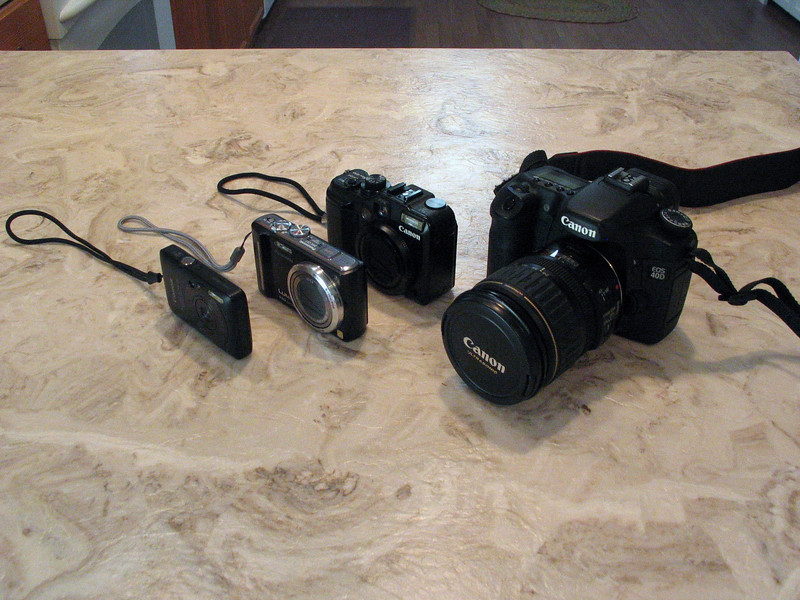 Left to right, Canon SD780IS (Barbara's Camera)<br /> Panasonic Lumix DMC-ZS7, <br /> Canon S10, <br /> Canon 40D
