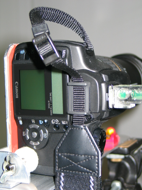 The camera comes with a rubber cover for the viewfinder attached to the strap. It is necessary to cover the viewfinder if you are not looking through it to prevent erroneous readings. It is a regular SLR.